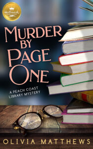 A blurred blue background. Title in pink text to the left: Murder by Page One. Gold circle above the text: Hallmark Publishing with Crown logo. White text beneath title: A Peach Coast Library Mystery. Author name in cream text at the bottom: Olivia Matthews. Right: Untidy stack of books on a weathered wooden shelf next to a pair of broken eyeglasses.